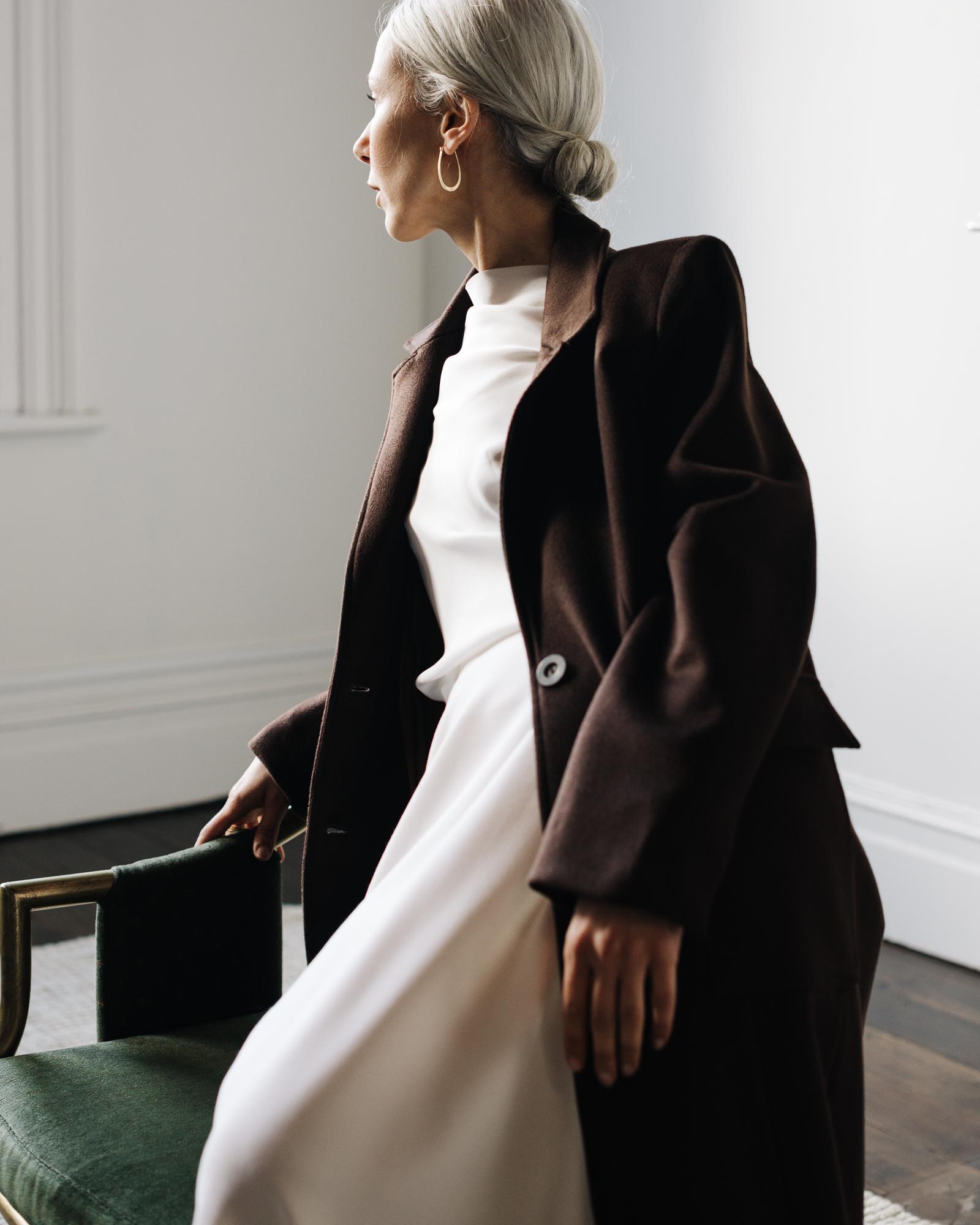 Pilot Client Mina, model wears coat in Auckland studio.